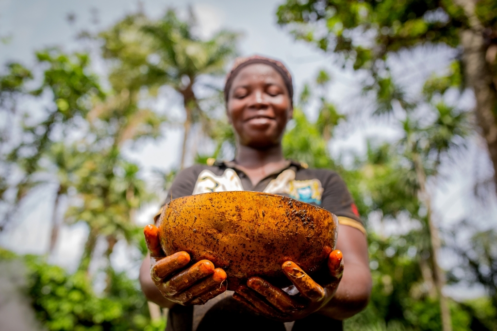 767615376-The-almost-finished-product-is-checked-in-a-calabash-by-one-of-the-pregnant-producers